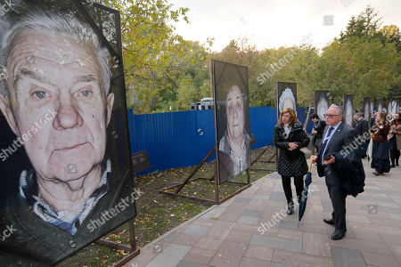 Visitors pass by portraits of victims of Nazi concentration camps throughout Europe installed in Babi Yar ravine where Nazi troops machine-gunned tens of thousands of Jews during WWII, in Kiev, Ukraine, . Ukraine marked the 75th anniversary of the 1941 Babi Yar massacre