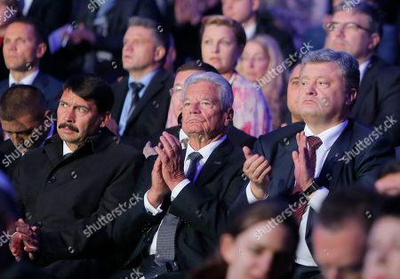 Janos Ader, Petro Poroshenko, Joachim Gauck Left to right: Hungarian President Janos Ader, German President Joachim Gauck and Ukraine's President Petro Poroshenko applaud at a memorial concert on the 75th anniversary of the 1941 Babi Yar massacre in Kiev, Ukraine, . Nazi troops machine-gunned tens of thousands of Jews during WWII in Babi Yar ravine