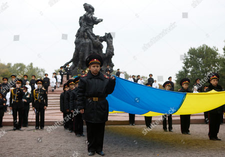 Kiev Cadets hold the national flag of Ukraine during commemoration events in Babi Yar ravine where Nazi troops machine-gunned tens of thousands of Jews during WWII, in Kiev, Ukraine, . Ukraine marked the 75th anniversary of the 1941 Babi Yar massacre