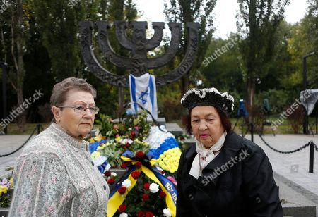 Women stand near the Menorah monument in Babi Yar ravine where Nazi troops machine-gunned tens of thousands of Jews during WWII, in Kiev, Ukraine, . Ukraine marked the 75th anniversary of the 1941 Babi Yar massacre