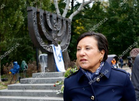 Penny Pritzker U.S. Commerce Secretary Penny Pritzker stands near the Menorah monument in Babi Yar in Kiev, Ukraine, . Ukraine marked the 75th anniversary of the 1941 Babi Yar massacre, where tens of thousands of jews were killed by Nazi troops