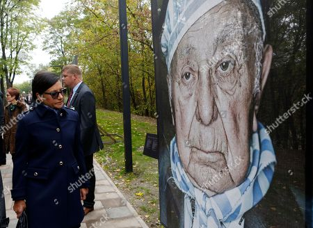 Penny Pritzker U.S. Commerce Secretary Penny Pritzker, left, attends a tour in Babi Yar ravine where Nazi troops machine-gunned tens of thousands of Jews during WWII, in Kiev, Ukraine, . Ukraine marked the 75th anniversary of the 1941 Babi Yar massacre