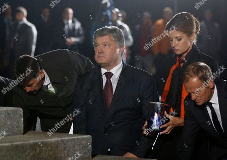Janos Ader, Petro PoroshenkoMaryna PoroshenkoDonald Tusk Hungarian President Janos Ader, left, Ukrainian President Petro Poroshenko, centre, and his wife Maryna Poroshenko, second right, with President of the European Council Donald Tusk, right, holding candles during commemoration ceremony at the Menorah monument in Babi Yar ravine where Nazi troops machine-gunned tens of thousands of Jews during WWII, in Kiev, Ukraine, . Ukraine marked the 75th anniversary of the 1941 Babi Yar massacre