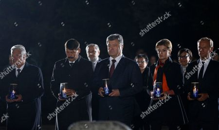 Joachim Gauck, Janos Ader, Petro Poroshenko, Maryna Poroshenko, Donald Tusk German President Joachim Gauck,left, Hungarian President Janos Ader, second left, Ukrainian President Petro Poroshenko, centre, and his wife Maryna Poroshenko, second right, President of the European Council Donald Tusk, right, hold a candle during commemoration ceremony at the Menorah monument in Babi Yar ravine where Nazi troops machine-gunned tens of thousands of Jews during WWII, in Kiev, Ukraine, . Ukraine marked the 75th anniversary of the 1941 Babi Yar massacre