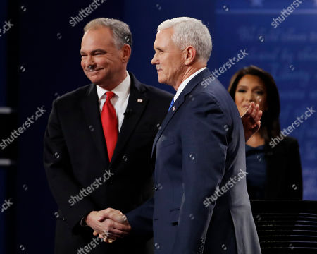 Moderator Elaine Quijano of CBS News watches as Republican vice-presidential nominee Gov. Mike Pence, right, shakes hands with Democratic vice-presidential nominee Sen. Tim Kaine during the vice-presidential debate at Longwood University in Farmville, Va