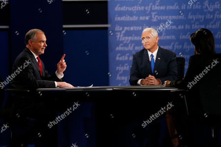 Republican vice-presidential nominee Gov. Mike Pence, right, and Democratic vice-presidential nominee Sen. Tim Kaine speak as Moderator Elaine Quijano of CBS News, right, listens during the vice-presidential debate at Longwood University in Farmville, Va