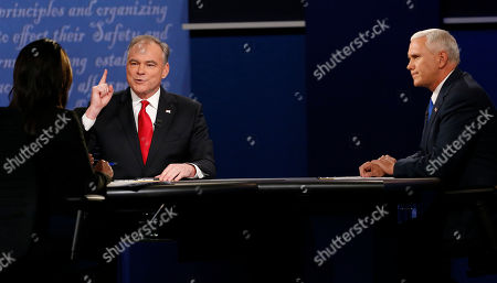 Stock Image of Republican vice-presidential nominee Gov. Mike Pence, right, and Democratic vice-presidential nominee Sen. Tim Kaine debate as Moderator Elaine Quijano of CBS News, far left, looks on during the vice-presidential debate at Longwood University in Farmville, Va