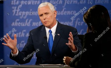 Republican vice-presidential nominee Gov. Mike Pence, left, speaks with Moderator Elaine Quijano of CBS News, right, as Democratic vice-presidential nominee Sen. Tim Kaine, not seen, listens during the vice-presidential debate at Longwood University in Farmville, Va