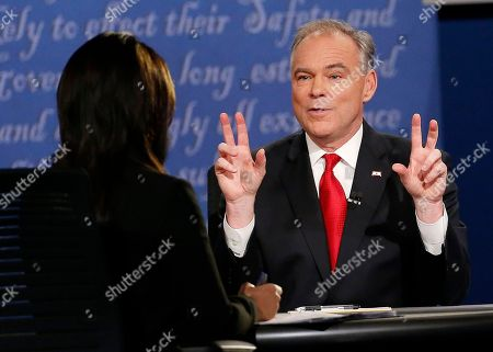Democratic vice-presidential nominee Sen. Tim Kaine speaks with Moderator Elaine Quijano of CBS News, left, as Republican vice-presidential nominee Gov. Mike Pence, not seen, listens during the vice-presidential debate at Longwood University in Farmville, Va