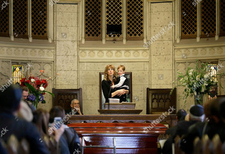 "Stock Photo of Carol Vigoda-Fuchs Abe Vigoda's daughter Carol Vigoda-Fuchs speaks while holding his great-grandson Johnathan Fuchs during a funeral service for Abe Vigoda in New York, . The actor who played Phil Fish on the 1970s TV series ""Barney Miller"" and Sal Tessio in the classic movie ""The Godfather"" was mourned at a funeral Sunday in New York"