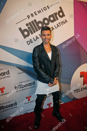 Christian Daniel Puerto Rican singer Christian Daniel poses on the Red Carpet after a news conference announcing the finalists for the 2016 Billboard Latin Music Awards, in Miami. The awards show will be broadcast live on Telemundo, April 28