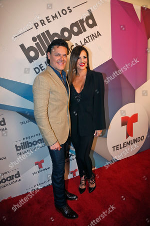 Pedro Fernandez, Gaby Espino Pedro Fernandez, left, and Gaby Espino, official hosts for the 2016 Billboard Latin Music Awards, poses on the Red Carpet after a news conference announcing the finalists for the 2016 Billboard Latin Music Awards, in Miami. The awards show will be broadcast live on Telemundo, April 28