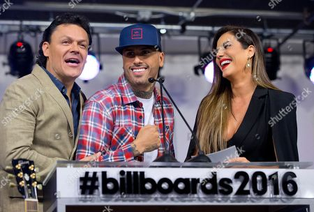 Pedro Fernandez, Gaby Espino, Nicky Jam Pedro Fernandez, left, and Gaby Espino, right, official hosts for the 2016 Billboard Latin Music Awards, share a laugh with singer songwriter Nicky Jam, center, during a news conference for the 2016 Billboard Latin Music Awards, in Miami. The awards show will be broadcast live on Telemundo, April 28
