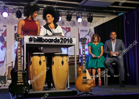 Aymee Nuviola, Jeimy Osorio, Ana Maria Canseco, Daniel Sarcos Actresses Jeimy Osorio, left, of Puerto Rico, and Aymee Nuviola of Cuba, help announce finalists for the 2016 Billboard Latin Music Awards as hosts Ana Maria Canseco, second from right, and Daniel Sarcos, right, look on during a news conference, in Miami. The awards show will be broadcast live on Telemundo, April 28