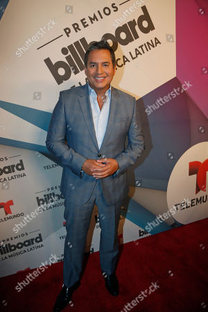 Stock Photo of Daniel Sarcos Venezuelan television personality Daniel Sarcos poses on the Red Carpet after a news conference announcing the finalists for the 2016 Billboard Latin Music Awards, in Miami. The awards show will be broadcast live on Telemundo, April 28
