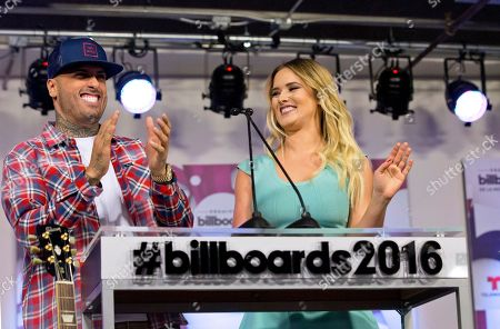 Stock Image of Kimberly Dos Ramos, Nicky Jam Singer songwriter Nicky Jam, left, and Venezuelan singer and actress Kimberly Dos Ramos appear during a news conference announcing the nominees for the 2016 Billboard Latin Music Awards, in Miami. The awards show will be broadcast live on Telemundo, April 28