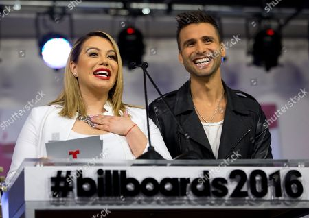 Chiquis Rivera, Christian Daniel Singer and television personality Chiquis Rivera, left, and Puerto Rican singer Christian Daniel help announce finalists for the 2016 Billboard Latin Music Awards during a news conference, in Miami. The awards show will be broadcast live on Telemundo, April 28