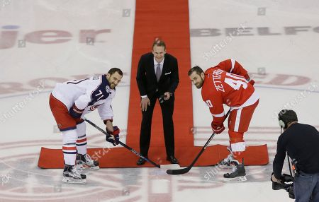 Stock Picture of Nicklas Lidstrom Former Detroit Red Wings defenseman Nicklas Lidstrom participates in a ceremonial puck drop with Red Wings captain Henrik Zetterberg, right, and Columbus Blue Jackets captain Nick Foligno during pre game of an NHL hockey game