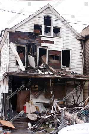 Rubble is visible at the front of a boarding house after a fatal fire, in Pittsburgh. Fire Chief Darryl Jones said heavy flames were visible when crews arrived, and the fire was so intense that it set off an alarm next door