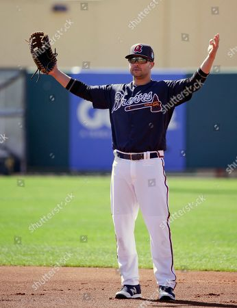 Atlanta Braves' Nick Swisher waits for a ground ball to field in a drill during a spring training baseball workout, in Kissimmee, Fla