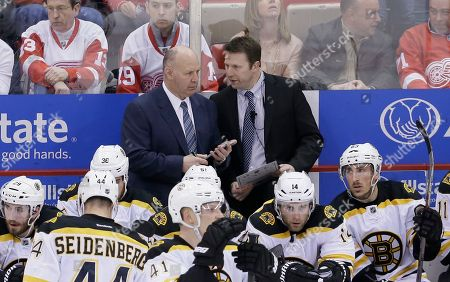 Claude Julien, Joe Sacco Boston Bruins head coach Claude Julien, left, and assistant Joe Sacco talk during the third period of an NHL hockey game against the Detroit Red Wings, in Detroit