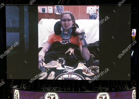 Hockey player Denna Laing, who was injured during a women's game at the Winter Classic in Foxborough, Mass., speaks from her hospital bed on a large television screen before an NHL hockey game between the Boston Bruins and the Vancouver Canucks, in Boston