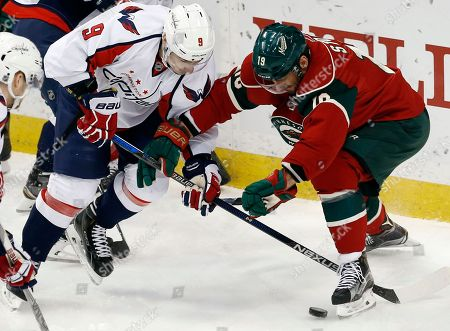 Dmitry Orlov, Jarret Stoll Washington Capitals' Dmitry Orlov, left, of Russia, tries to get to the puck as Minnesota Wild's Jarret Stoll defends with a broken stick in the third period of an NHL hockey game, in St. Paul, Minn. The Capitals won 4-3