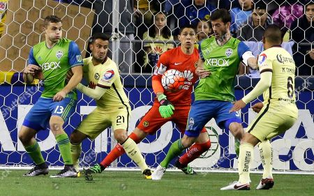 Hugo Gonzalez, Jordan Morris Seattle Sounders forward Jordan Morris, left, and defender Brad Evans, second from right, battle for the ball with Club America's Jose Guerrero, second from left, and Miguel Samudio, right, as Club America goalkeeper Hugo Gonzalez, center, watches during the first half of a CONCACAF Champions League soccer quarterfinal, in Seattle