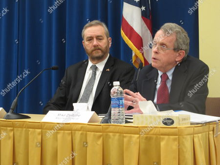Stock Image of Mike DeWine, David Yost Ohio Attorney General Mike DeWine, right, responds to a question on medical marijuana legislation in a Q&A session with state Auditor David Yost, at a forum for journalists organized by The Associated Press,, in Columbus, Ohio. DeWine said it's up to the legislature, while noting ongoing clinical trials examining the use of medical marijuana. Yost said he supports tightly controlled medical marijuana