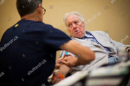 John Jay Hooker, Steve Bell John Jay Hooker, right, talks with technician Steve Bell as Bell hooks up an IV during a cancer treatment for Hooker in Nashville, Tenn. Hooker, a large figure in Tennessee politics who once worked as special counsel to Robert Kennedy, spent his last days fighting to make physician-assisted suicide legal in Tennessee. Hooker died, in Nashville. He was 85