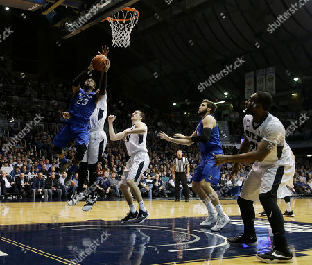 Creighton's James Milliken (23) puts puts up a shot against Butler's Kelan Martin (30) during the second half of an NCAA college basketball game, in Indianapolis. Butler won 88-75