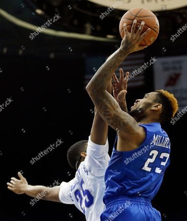 Rashed Anthony, James Milliken Creighton guard James Milliken (23) goes up for a shot against Seton Hall forward Rashed Anthony during the first half of an NCAA basketball game, in Newark, N.J