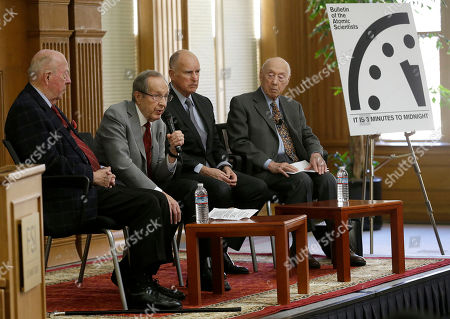 "Jerry Brown, William Perry, George Shultz Former U.S. Secretary of Defense William Perry, second from left, speaks next to former U.S. Secretary of State George Shultz, from left, Gov. Jerry Brown, and Jerry Seelig after the unveiling of the ""Doomsday Clock,""which measures the likelihood of a global cataclysm, at Stanford University in Stanford, Calif., . The Bulletin of the Atomic Scientists announced that the minute hand on the metaphorical clock remained at three minutes-to-midnight. The clock reflects how vulnerable the world is to catastrophe from nuclear weapons, climate change and new technologies, with midnight symbolizing apocalypse"