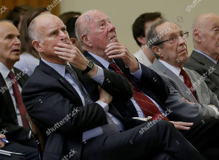 "Jerry Brown, William Perry, George Shultz California Gov. Jerry Brown, from left, former U.S. Secretary of State George Shultz and former U.S. Secretary of Defense William Perry listen to speakers on a video screen before the unveiling of the ""Doomsday Clock,"" which measures the likelihood of a global cataclysm, at Stanford University in Stanford, Calif., . The Bulletin of the Atomic Scientists announced that the minute hand on the metaphorical clock remained at three minutes-to-midnight. The clock reflects how vulnerable the world is to catastrophe from nuclear weapons, climate change and new technologies, with midnight symbolizing apocalypse"