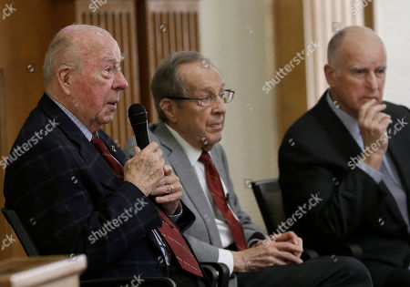 "Jerry Brown, William Perry, George Shultz Former U.S. Secretary of State George Shultz, left, speaks next to former U.S. Secretary of Defense William Perry, center, and California Gov. Jerry Brown after the unveiling of the ""Doomsday Clock,"" which measures the likelihood of a global cataclysm, at Stanford University in Stanford, Calif., . The Bulletin of the Atomic Scientists announced that the minute hand on the metaphorical clock remained at three minutes-to-midnight. The clock reflects how vulnerable the world is to catastrophe from nuclear weapons, climate change and new technologies, with midnight symbolizing apocalypse"
