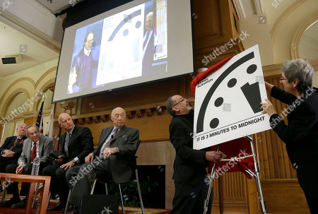 "Jerry Brown, William Perry, George Shultz The Bulletin of the Atomic Scientists member Lynn Eden, right, and editor-in-chief John Mecklin, second from right, unveil the ""Doomsday Clock,"" which measures the likelihood of a global cataclysm, at Stanford University in Stanford, Calif., . Also pictured are former U.S. Secretary of State George Shultz, from left, former U.S. Secretary of Defense William Perry, Gov. Jerry Brown, and Jerry Seelig. The bulletin announced that the minute hand on the metaphorical clock remained at three minutes-to-midnight. The clock reflects how vulnerable the world is to catastrophe from nuclear weapons, climate change and new technologies, with midnight symbolizing apocalypse"