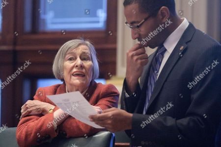 Illinois Rep. Barbara Flynn Currie, D-Chicago, left, and Illinois Rep. Christian Mitchell, D-Chicago, right, talk while on the House floor during session at the state Capitol, in Springfield, Ill
