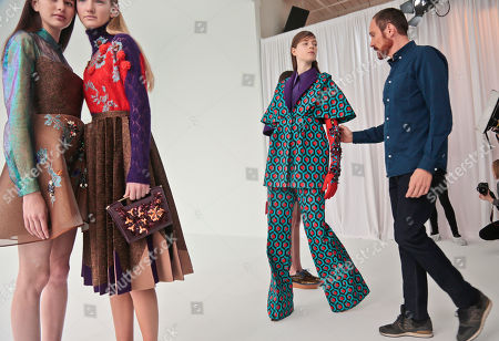 Delpozo Fall-Winter 2016 Delpozo designer Josep Font, right, makes last-minute checks backstage before showing the Delpozo Fall-Winter 2016 collection during Fashion Week, in New York