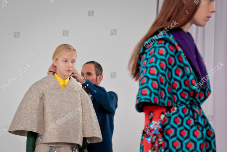 Delpozo Fall-Winter 2016 Delpozo designer Josep Font, center, makes last-minute checks backstage before showing the Delpozo Fall-Winter 2016 collection during Fashion Week, in New York