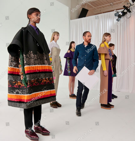 Delpozo Fall-Winter 2016 Delpozo designer Josep Font, third from right, makes last-minute rounds backstage before showing the Delpozo Fall-Winter 2016 collection during Fashion Week, in New York