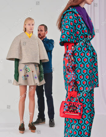 Delpozo Fall-Winter 2016 Delpozo designer Josep Font, center, makes last-minute checks backstage before showing Delpozo Fall-Winter 2016 collection during Fashion Week, in New York