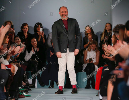 Stock Picture of Peter Copping Peter Copping steps out to applause from the audience after the modeling of the Oscar de la Renta Fall 2016 collection during Fashion Week, in New York