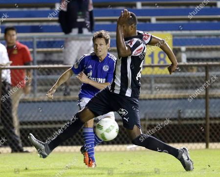 Erazo, Sascha Riether Atletico Mineiro's Erazo, foreground, is unable to stop a kick by FC Schalke 04's Sascha Riether, background, during the second half of the Florida Cup friendly soccer match in Fort Lauderdale, Fla., . Atletico Mineiro won 3-0