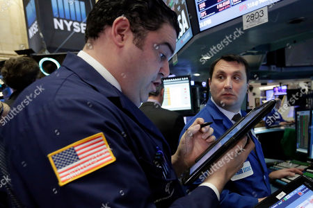 Robert McQuade, Vincent Surace Trader Robert McQuade, left, and specialist Vincent Surace work on the floor of the New York Stock Exchange, . Energy stocks are leading another sell-off on Wall Street as the price of oil continues to plunge