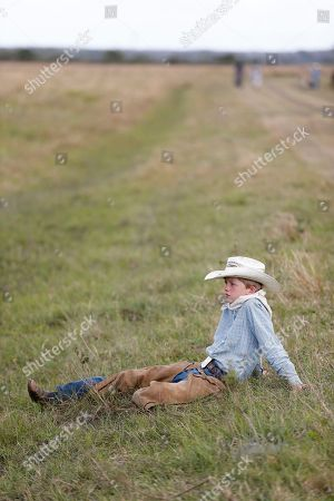 Matthew Lawrence Matthew Lawrence, 12, of Okeechobee, Fla., takes a break during lunch during the second day of the Great Florida Cattle Drive 2016, in Kenansville, Fla