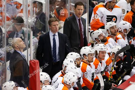 Stock Photo of Dave Hakstol, Ian Laperriere, Gord Murphy Philadelphia Flyers head coach Dave Hakstol, center, stands with assistants Ian Laperriere, left, and Gord Murphy, right, behind his bench during an NHL hockey game against the Pittsburgh Penguins in Pittsburgh