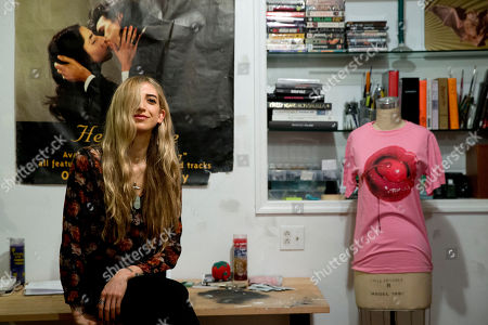 "Stock Image of Fashion designer Lyz Olko poses for a portrait at her studio on the Lower East Side neighborhood of New York. Olko, who personally makes every piece in her namesake's collection, is a fan of using recycled materials and sustainable production methods. The 35-year-old New York City-based designer says her decision to eat a plant-based diet is ""about having a larger consciousness of the effect your actions have on people around you"