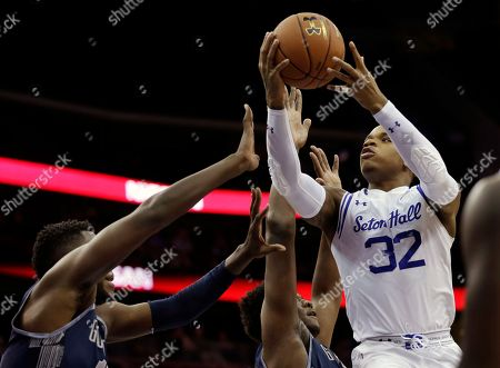 Derrick Gordon Seton Hall guard Derrick Gordon (32) goes up to shoot past Georgetown players during the first half of an NCAA college basketball game, in Newark, N.J