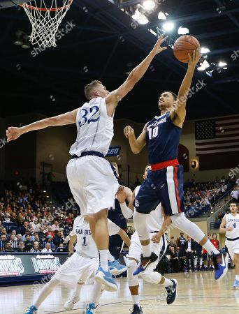 Bryan Alberts, Brett Bailey Gonzaga guard Bryan Alberts puts a shot up over the defense of San Diego forward Brett Bailey during the first half of an NCAA college basketball game, in San Diego