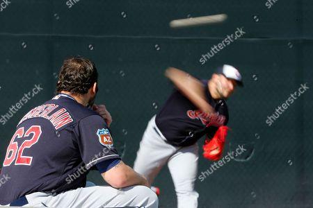 Joba Chamberlain, Felipe Paulino Cleveland Indians' Joba Chamberlain (62) watches Felipe Paulino, right, throw during a spring training baseball workout, in Goodyear, Ariz